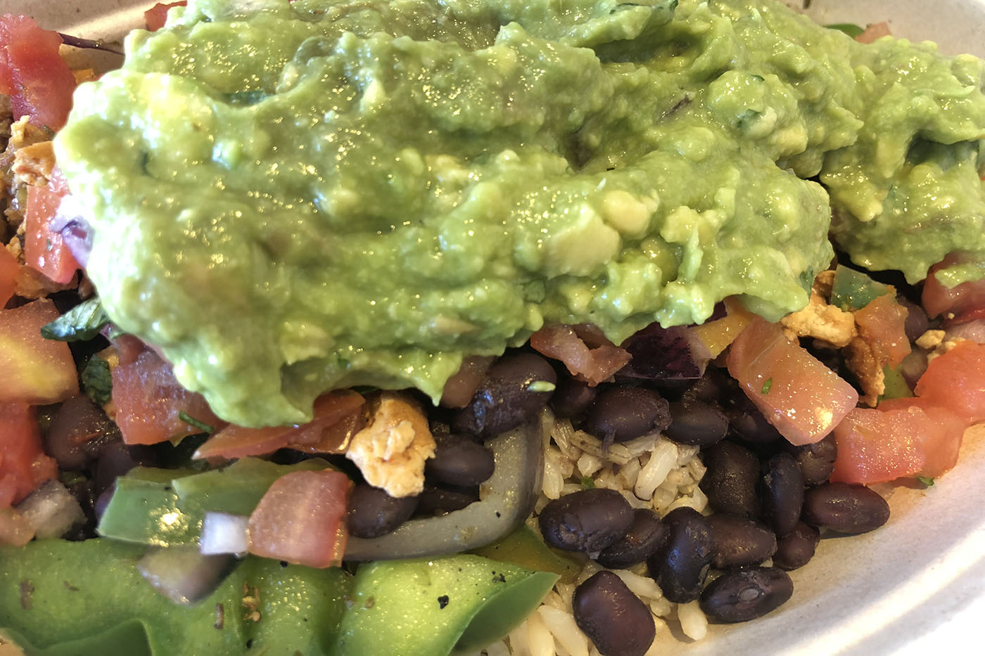 chipotle burrito bowl is vegan fast food with sofritas and guacamole