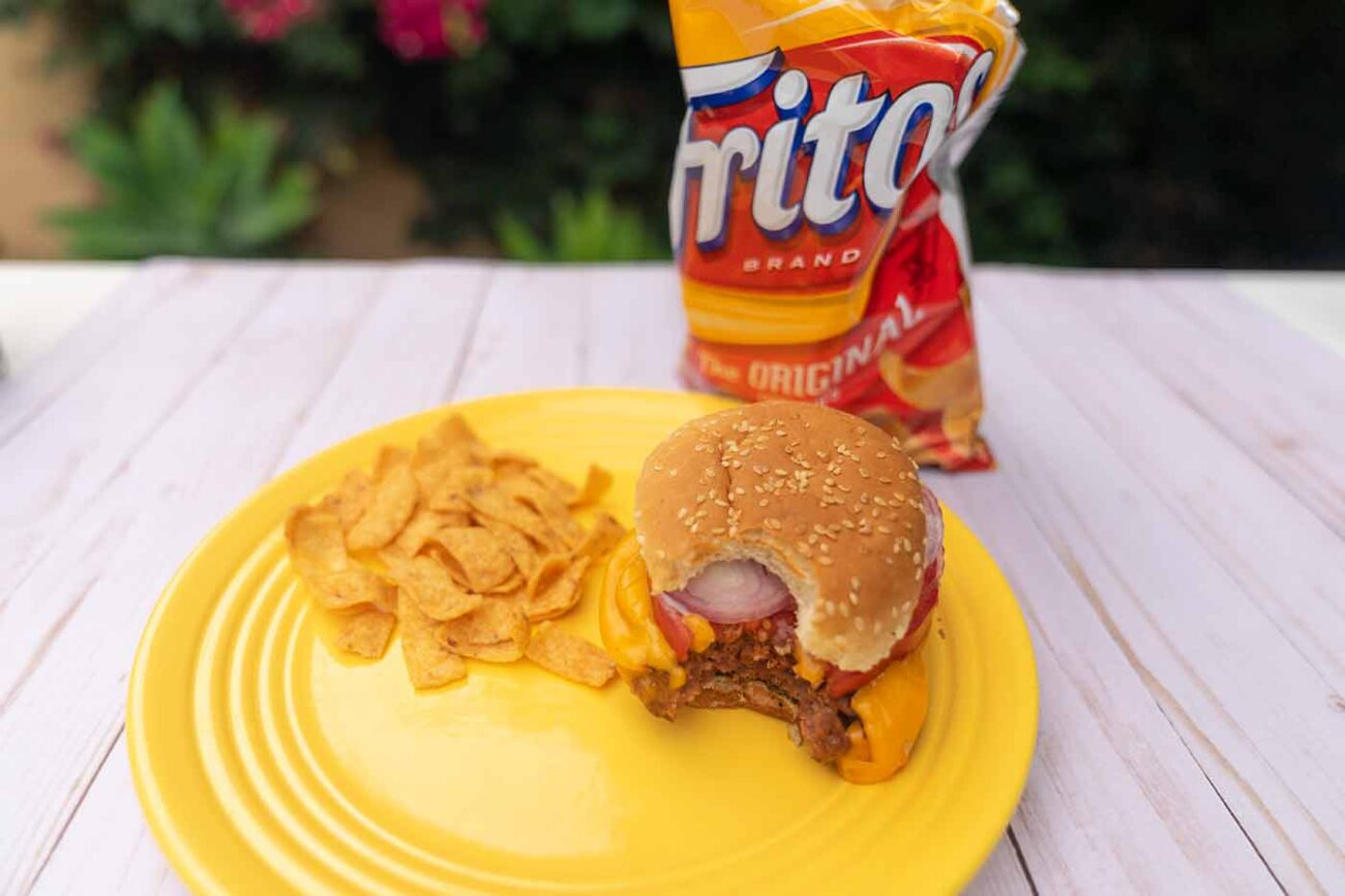 vegan junk food including a bag of Fritos and a Beyond Burger with Follow Your Heart cheese