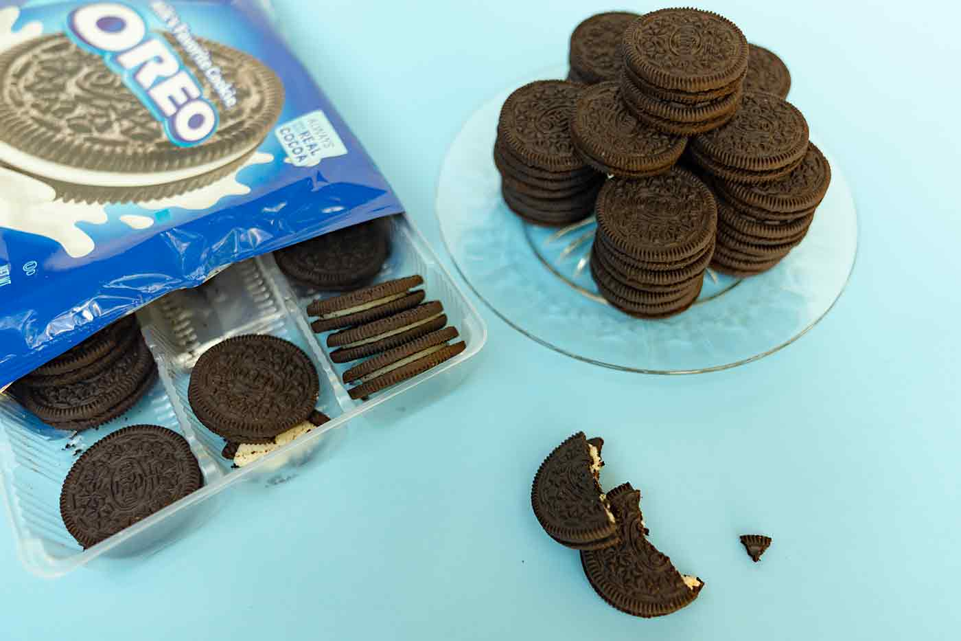 vegan Oreo cookies on a blue tabletop