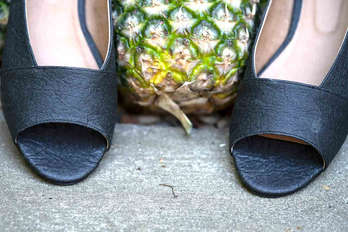 Pinatex shoes from Nae online shown with a pineapple used to make the vegan leather