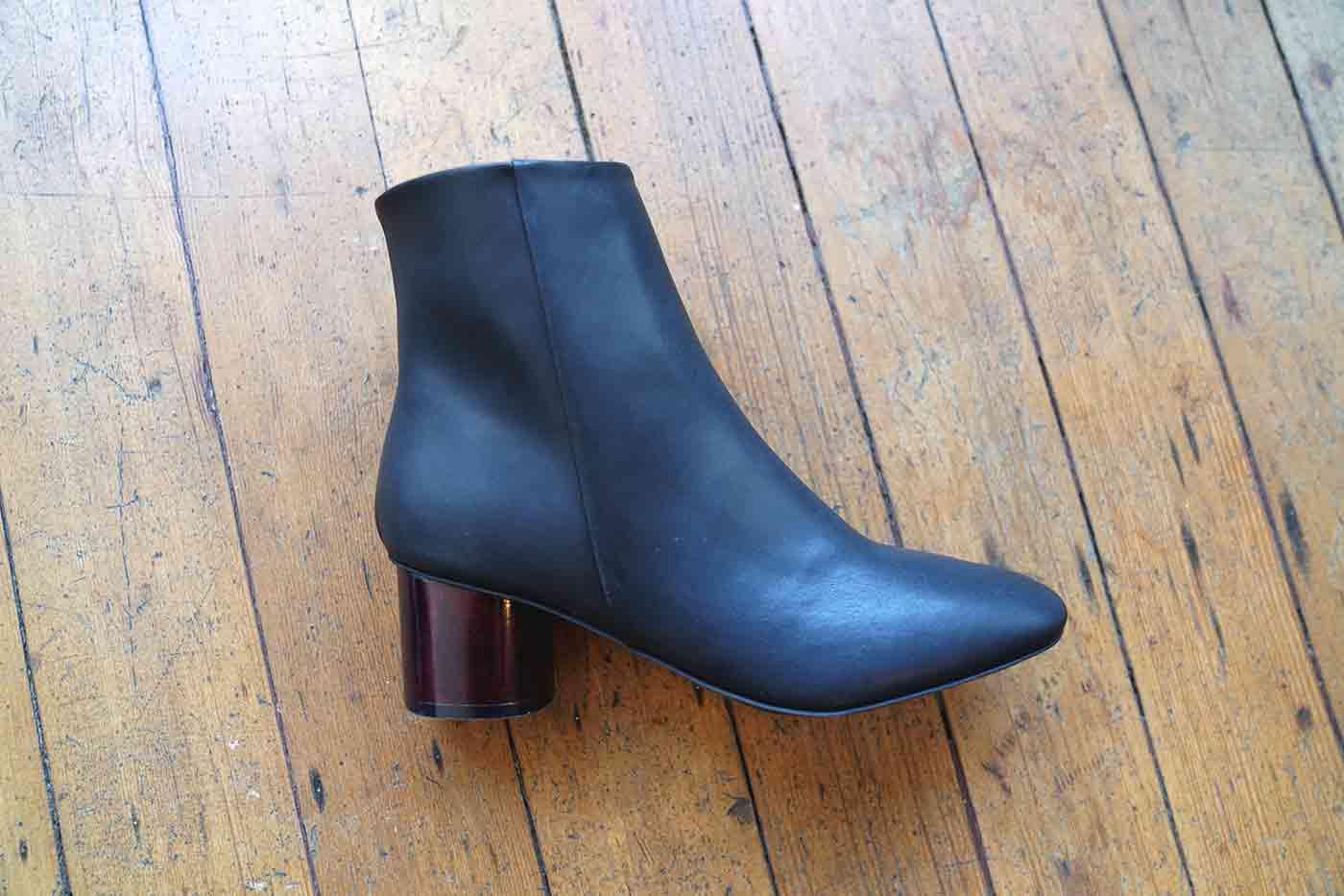 designer vegan black boot with a wooden heel