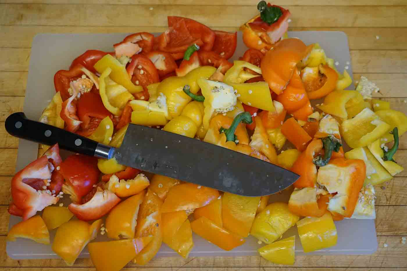 spoiled veggies chopped on a kitchen countertop for composting with nitrogen