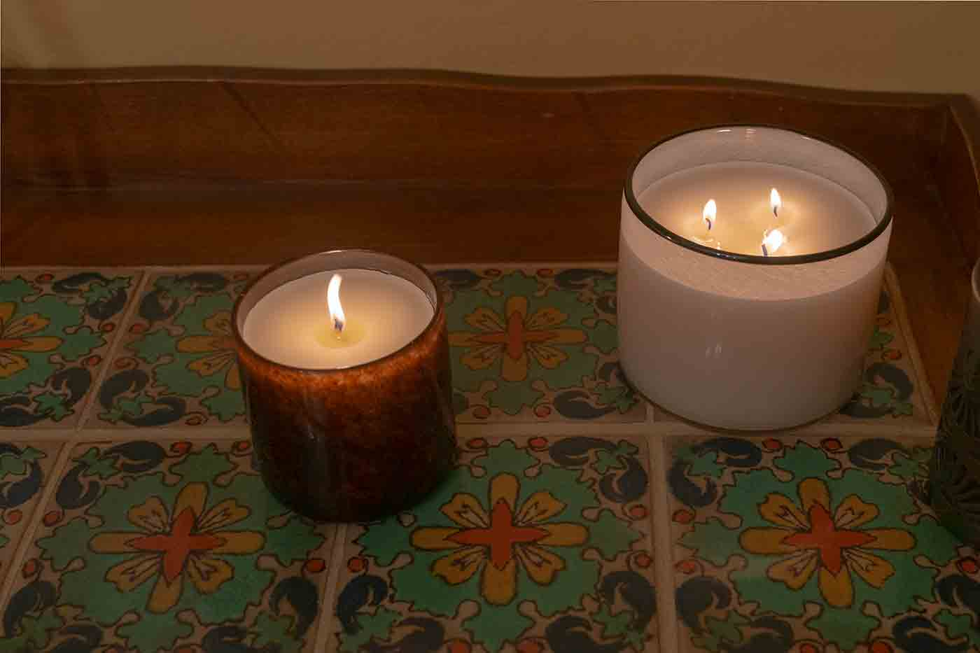 Redwood and Champaign LAFCO candles on a vintage tile sideboard