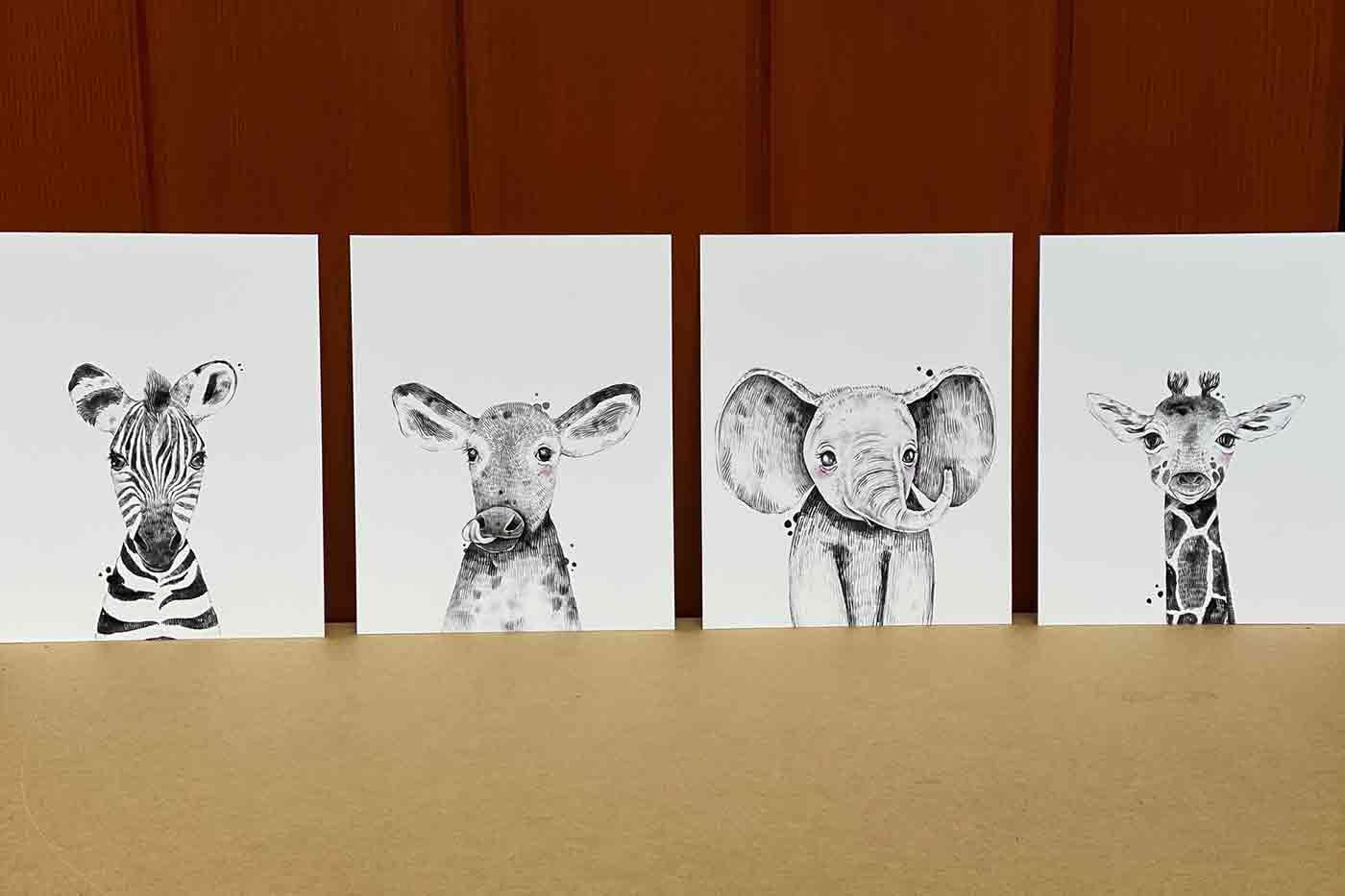 baby animal artwork for a nursery including a baby zebra a baby cow a baby elephant and a baby giraffe