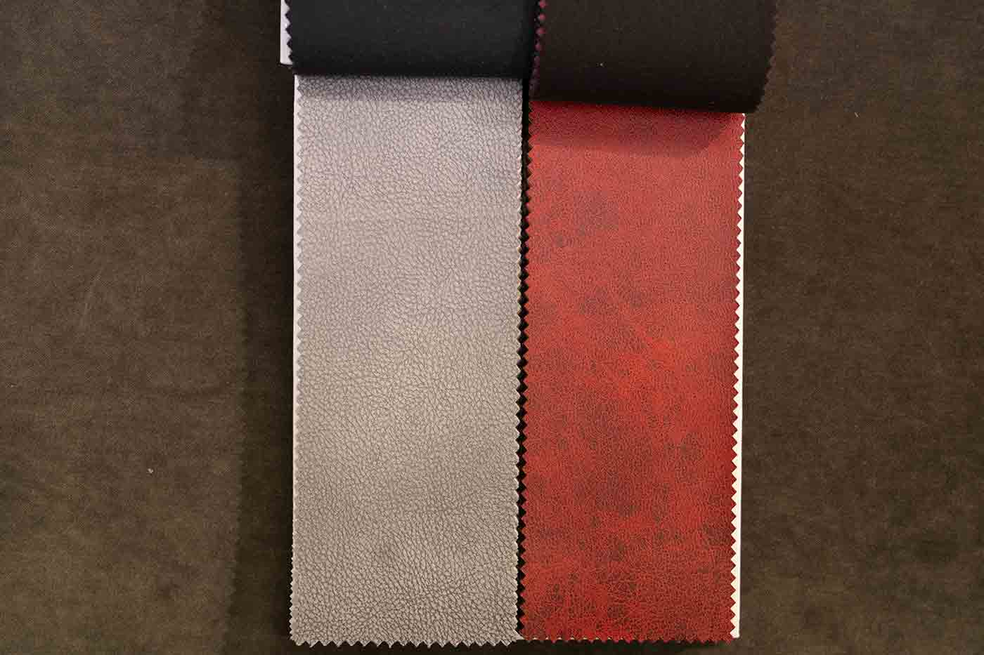 faux leather swatches in red and grey at Calico Corners in Pasadena sold as upholstery fabric