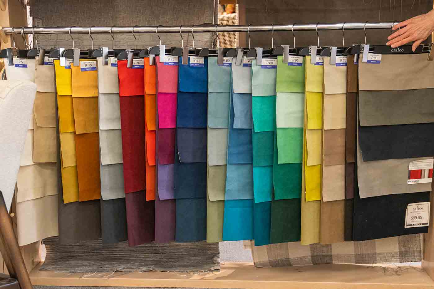 Sensuede faux suede swatches in a rainbow of colors plus neutrals at Calico Corners in Pasadena