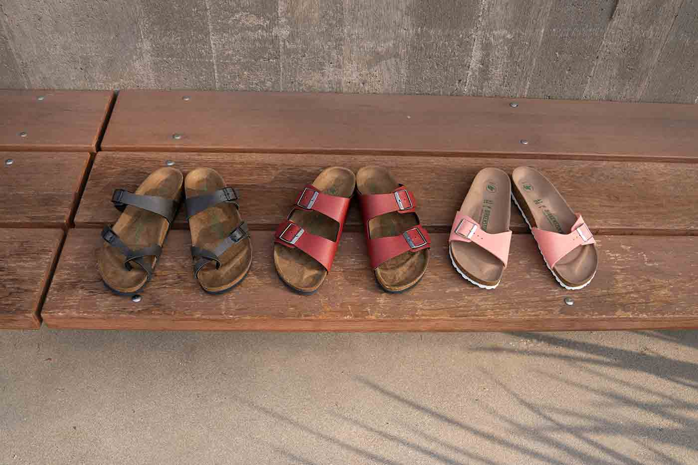 three of Birkenstocks most popular styles made of vegan leather
